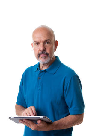 Portrait of mature man in blue polo shirt using electronic tablet isolated on white