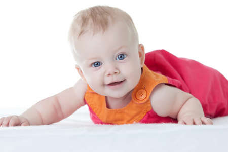 Cute baby-girl in dress, on her tummy isolated