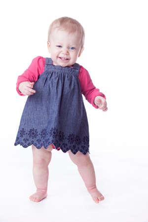 baby girl walking on white background