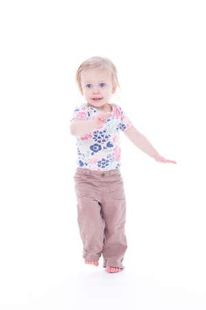 toddler girl dancing barefoot, isolated on white Imagens