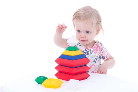 toddler girl stacking blocks, isolated on white Imagens