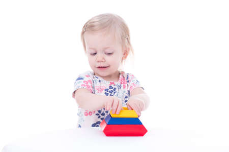 toddler girl stacking blocks, isolated on white Stock Photo