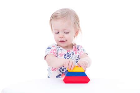 toddler girl stacking blocks, isolated on white Stock Photo