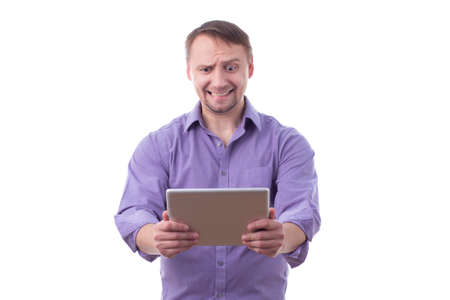 Man holding a tablet, funny expression, isolated on white