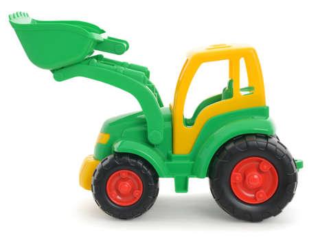 Children's plastic toy, yellow-green bulldozer isolated on white Foto de archivo