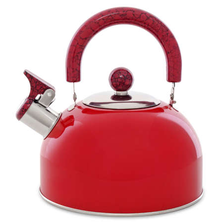 Red metal whistling kettle isolated on white
