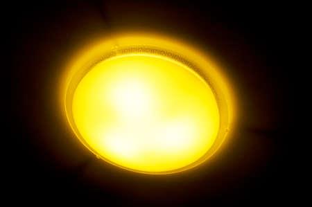 electric fixture: dark, luminous, pathway, structure illuminate The ceiling lamp on black Stock Photo
