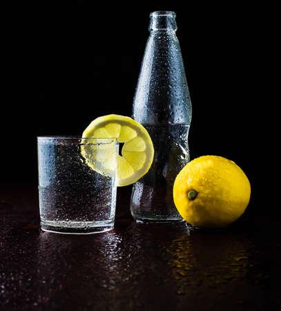 lemon wedge: fresh clear water with fresh water splash bubbles bottle