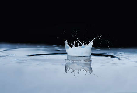 Milk drop in a spoon, splash, fresh, action, movement drink lifestyle nature Imagens
