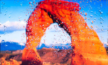 The red rocks of the Grand Canyon A view of the city from a window from a high point during a rain. Rain drops on glass. Focus on drops Imagens