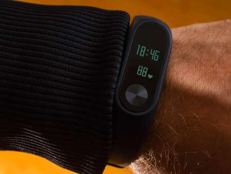 Fitness male bracelet smart, sport, activity, body, exercise, fitness gadget heart jogger marathon mobile Stock Photo