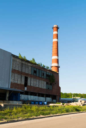 Isolated old aged weathered tall industrial factory chimney, red grungy brick smokestack grunge vintage Imagens
