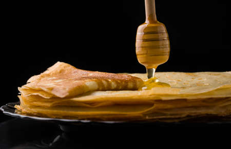 Pancakes. Thin pancakes. Russian bliny. maslenitsa, blini, breakfast, crepe, honey pastry stack pancake russian background caviar closeup food fresh Imagens - 101285882