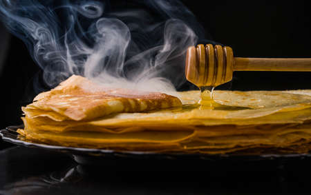 Pancakes. Thin pancakes. Russian bliny. maslenitsa, blini, breakfast, crepe, honey pastry stack pancake russian background caviar closeup food fresh Imagens - 101285941