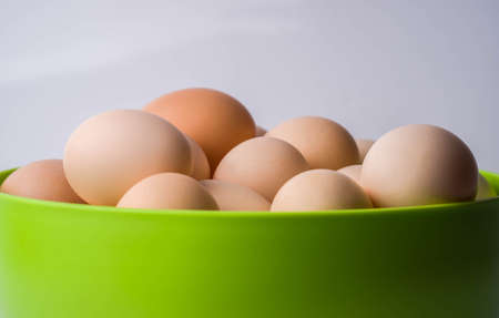 top view of eggs in bowl group, healthy, ingredient, life, macro, meal, nature, new, nutritious, object, old organic oval product protein retro shell uncooked yellow Imagens