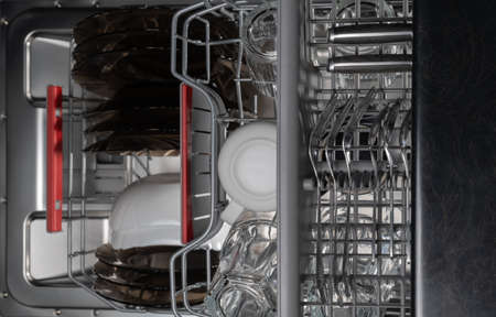Filling dirty dishes in the dishwasher woman, hand, water, house, fruit, technology, kitchen
