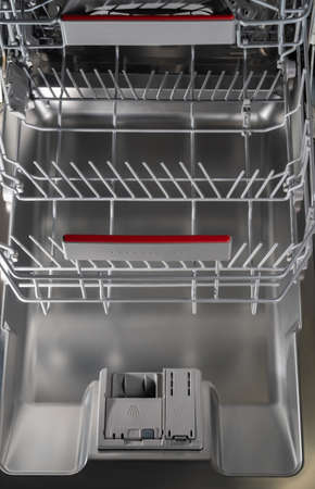 Filling dirty dishes in the dishwasher woman, hand, water, person, house, fruit technology kitchen Imagens