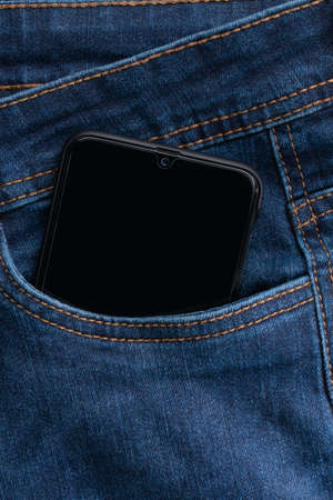 Close Up Smartphone in blue Jeans Back Pocket Bussines Fashion Stylish Screen Copy Space White Mobile Denim Hipster gadjet