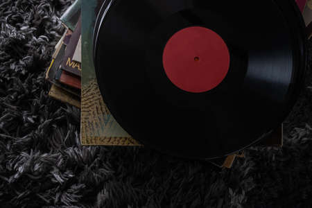 Beautiful vinyl records in a dark key very beautiful vintage artwork headphones for listening to music on records the old education modernity