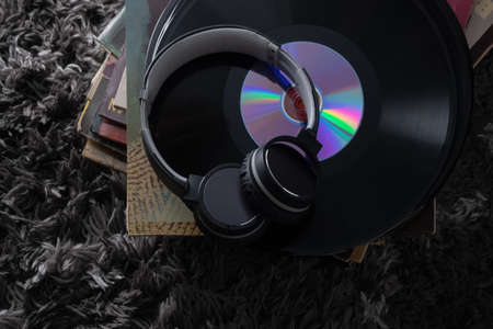 Beautiful vinyl records in a dark key very beautiful vintage artwork trendy abstract design headphones for listening to music on records the old Imagens