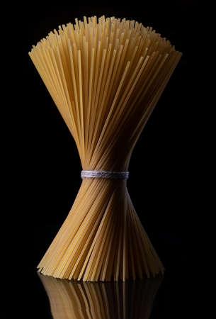 Pasta on dark background refined taste organic, ingredients, nest, flour, view, overhead, basil, preparations, delicious design food texture leaf kitchen