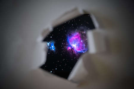 galaxy, space, uncharted, otherworldly, mystical, fantastic through a black hole in paper, a torn piece of paper with the universe galaxy background inside, elements of this image furnished, access to open space