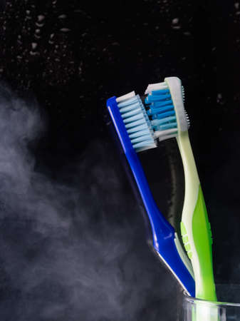 Toothbrushes in glass on table on light background healthcare, clean, healthy, dental, object, care, lifestyle, health hygiene Imagens