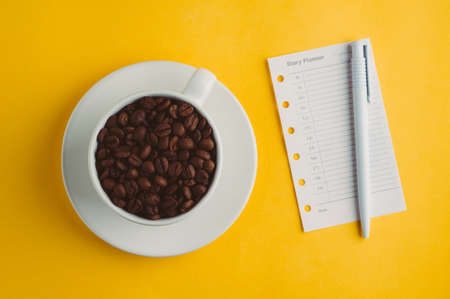 Cup with coffee grains  on a yellow background