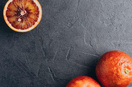Red oranges on a dark stone background Stok Fotoğraf - 73506099
