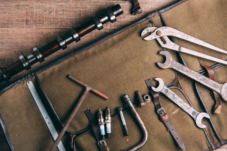 Old wrenches and auto parts. The concept of the garage