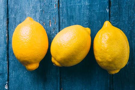 Lemons on blue background Stok Fotoğraf
