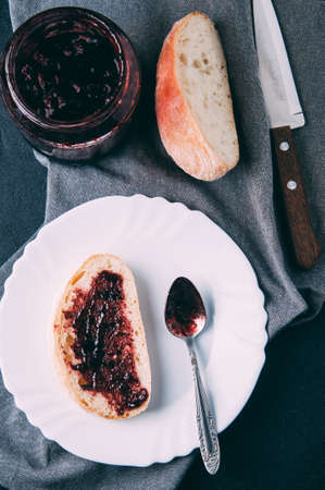 Bread and jam from a black currant