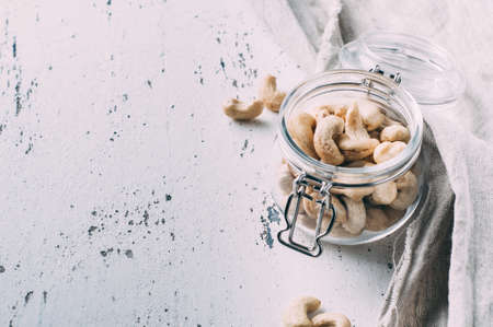 Cashew nuts in a jar on the old table Stock Photo