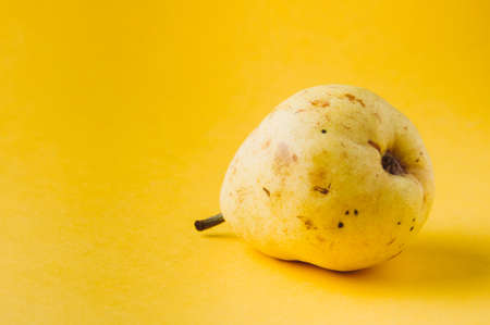 Ripe pear on a yellow background Stok Fotoğraf - 79389455