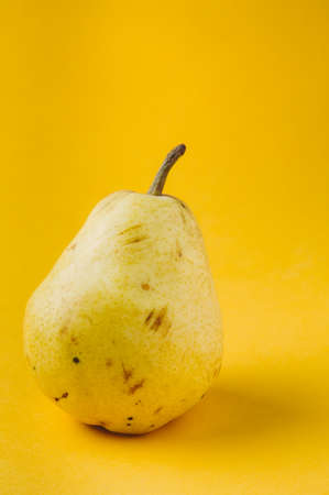 Ripe pear on a yellow background Stok Fotoğraf - 79389676