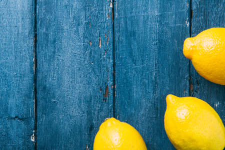 Lemons on blue background Stok Fotoğraf - 79389681