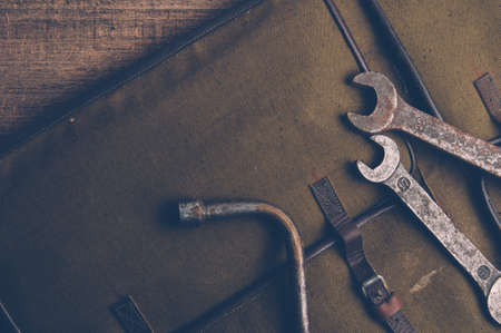 Old wrenches and bag Stock Photo