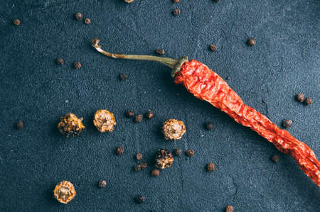 Red chili pepper on dark background