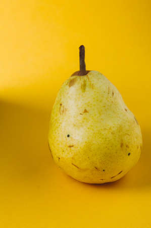 Ripe pear on a yellow background Stok Fotoğraf - 79389853
