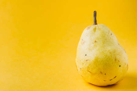 Ripe pear on a yellow background Stok Fotoğraf - 79389861