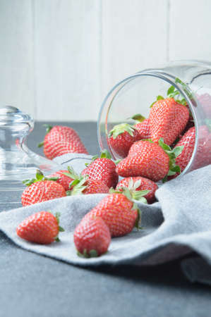 Ripe strawberry on a dark background