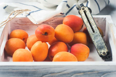 Fresh apricots in a white wooden box Stock Photo