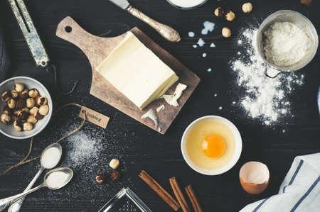 Baking ingredients on a dark wood background