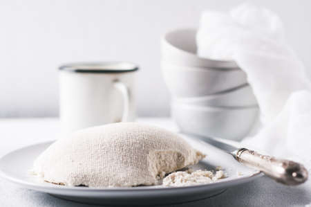Fresh homemade cheese on a white concrete background Stock Photo
