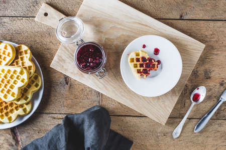 Homemade wafers and raspberry jam on a wooden table. Top view and flat lay Stock Photo