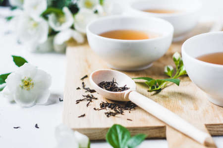 Green tea with a jasmine in white cups Stock Photo