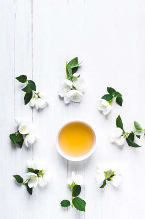 Green tea with a jasmine in white cups. Negative space for text or design
