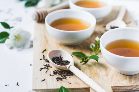 Green tea with a jasmine in white cups Stockfoto