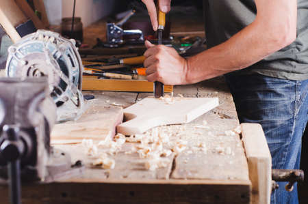 Carpenter with tools at work in the workshop