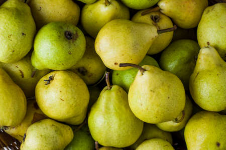 Background of ripe yellow pears. Top view Banco de Imagens